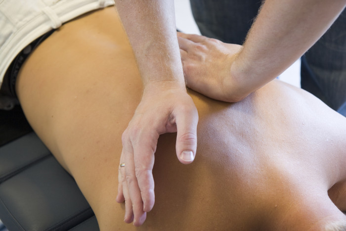 myofascial release therapy for a client, working away tension and pain.